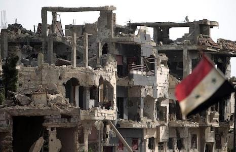 syria flag in the rubbles